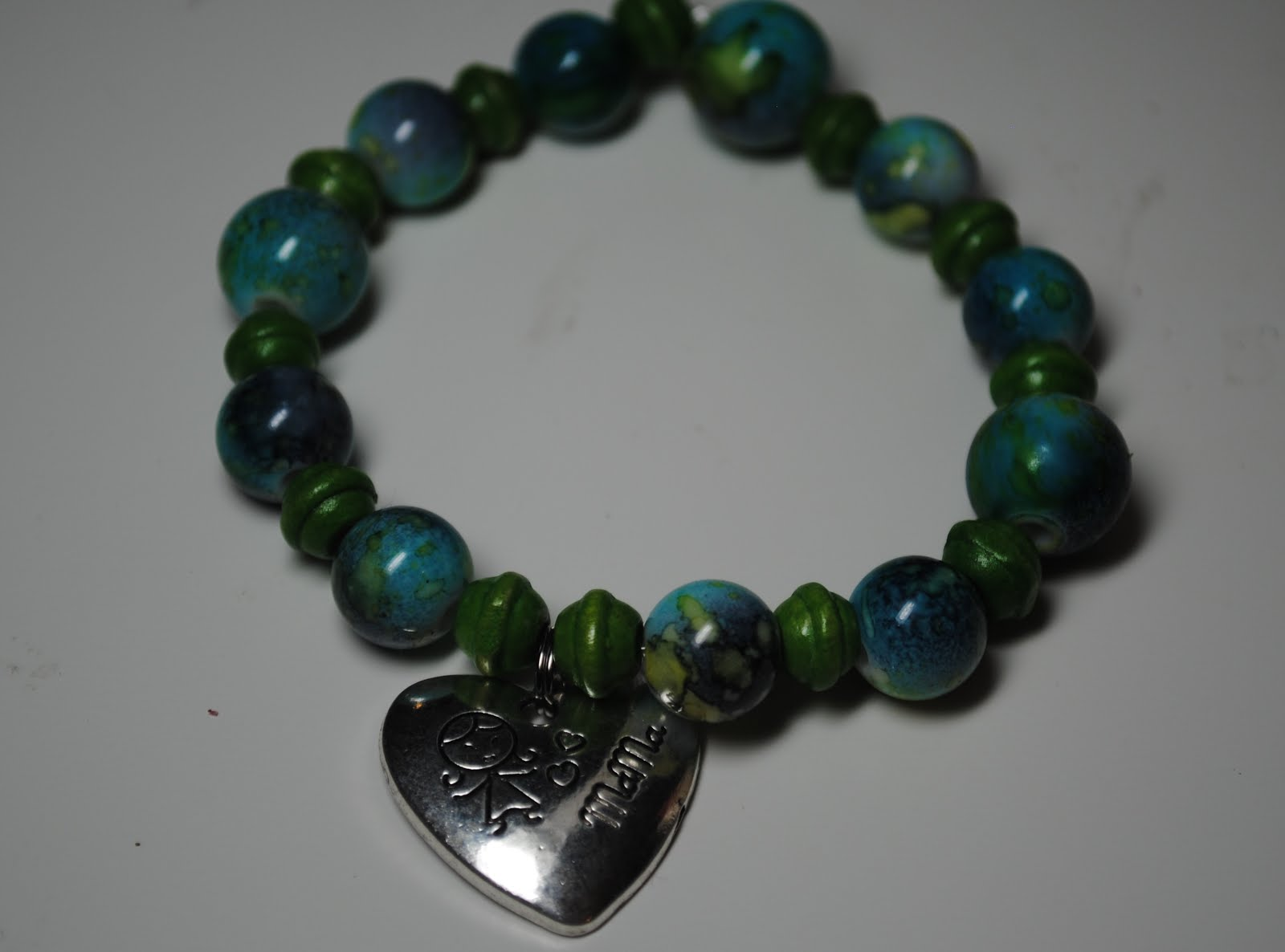 Around the World Blue/Green with Mama Charm