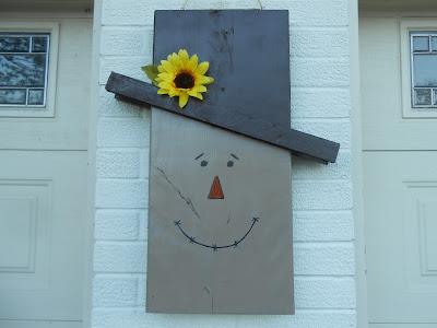 DIY wooden reversible scarecrow/snowman