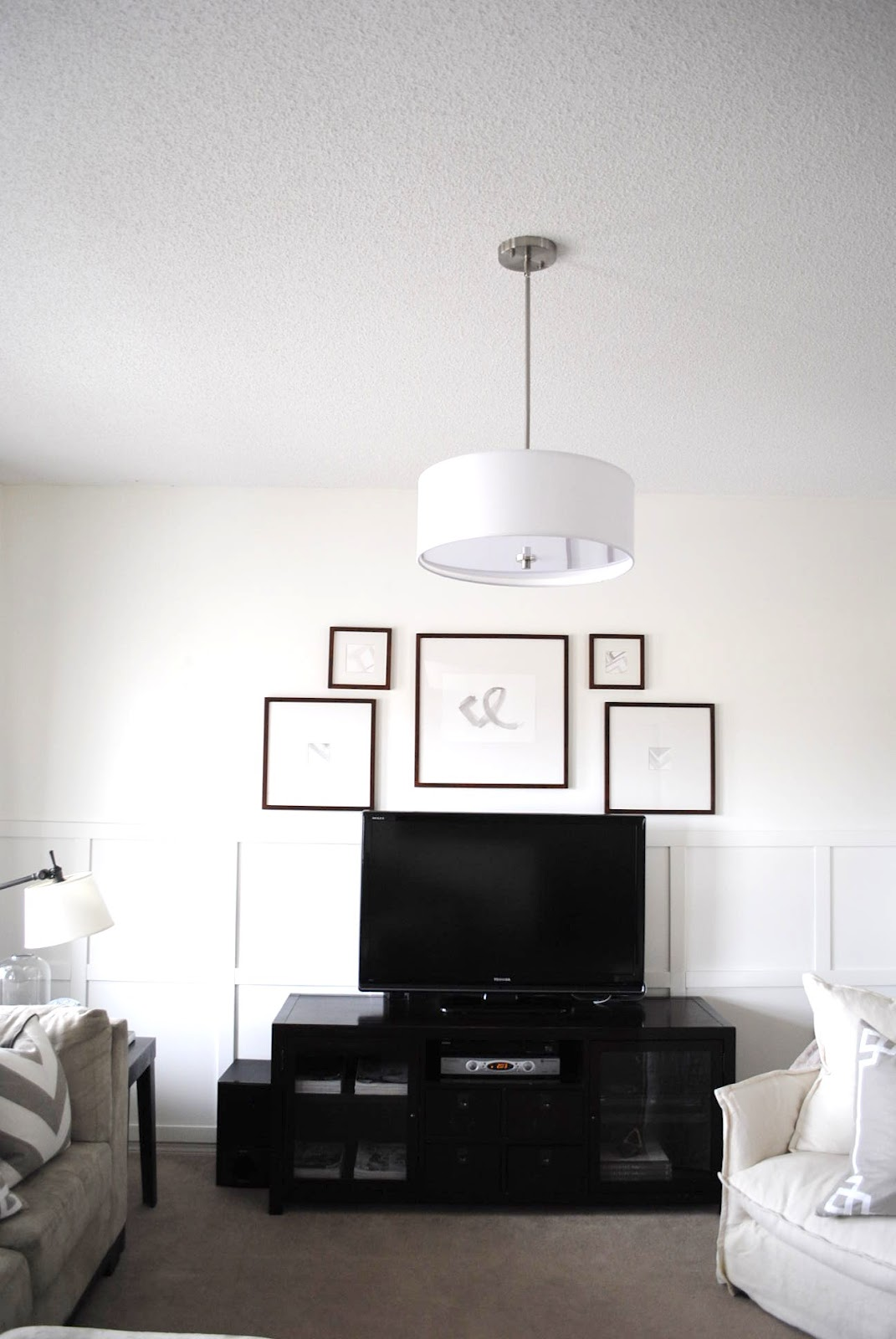 framing a TV with a gallery wall