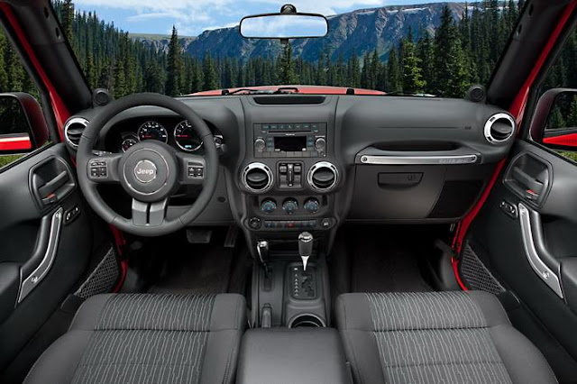 Interior view of 2012 Jeep Wrangler with panoramic mountain vista through windshield