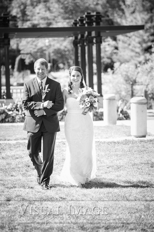 Father walking daughter at wedding in Frame Park