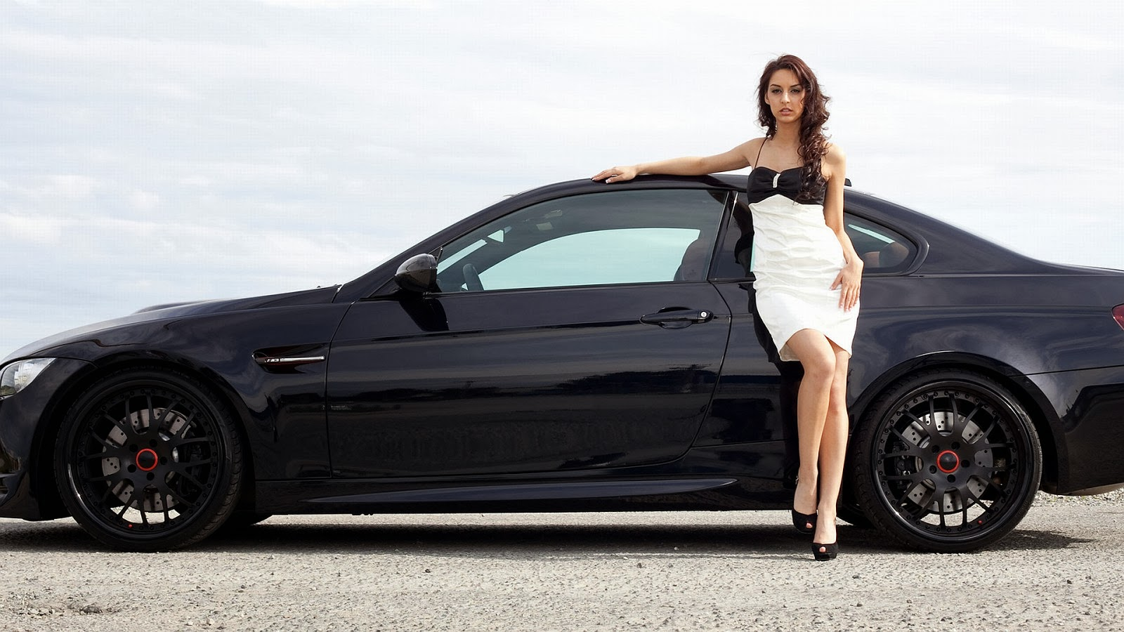 Beautiful-girl-model-with-latest-black-sports-car-HD-photo-collection.jpg