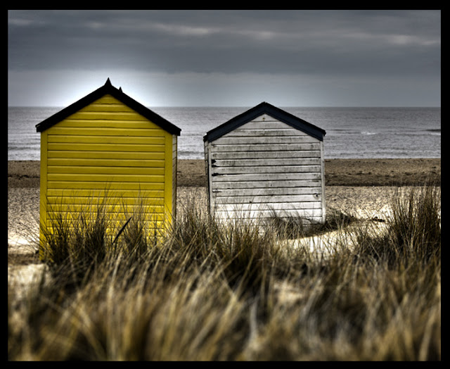 Beach Huts - Yellow House - North Sea England - Photograph by Tim Irving