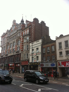 Ghost sign on Tottenham Court Road, London