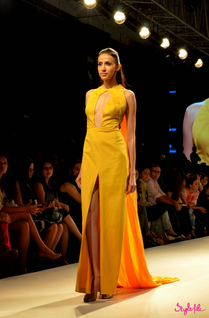 Model showcases a bright mango yellow gown with slit by designer Nikhil Thampi at Lakme Fashion Week Summer Resort 2015 in Mumbai