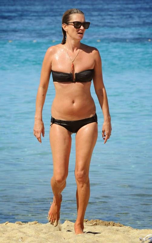 Kate Moss, 40, rocked a black strapless bikini