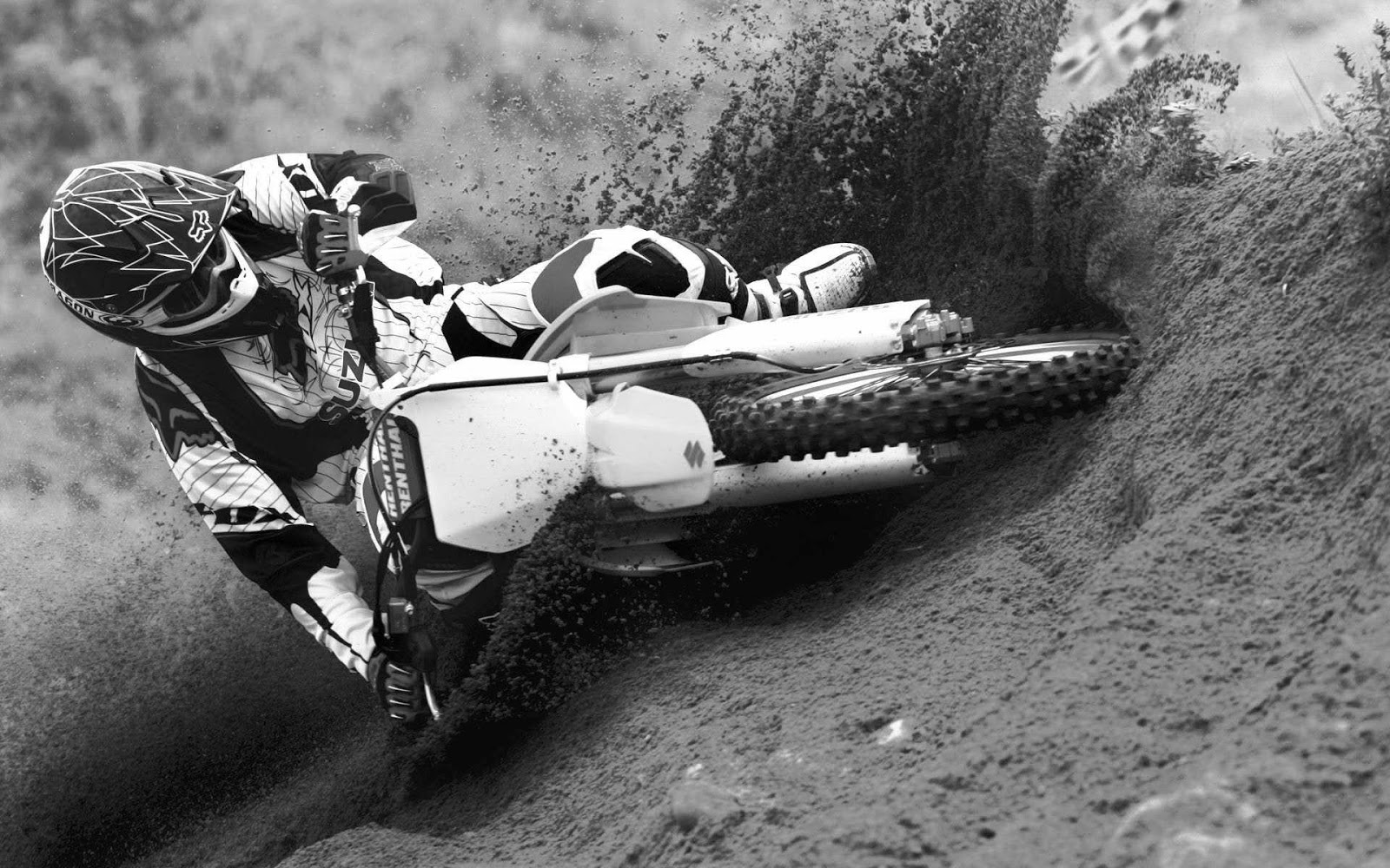 Riding through the mud dirt bike black and white wallpaper