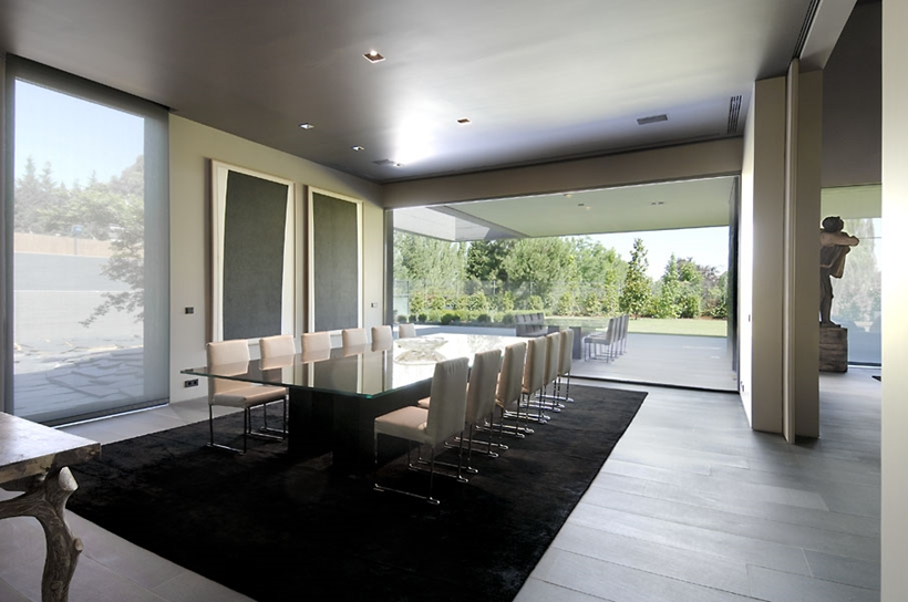 Dining table in Ultra Modern Concrete House by A-cero Architects