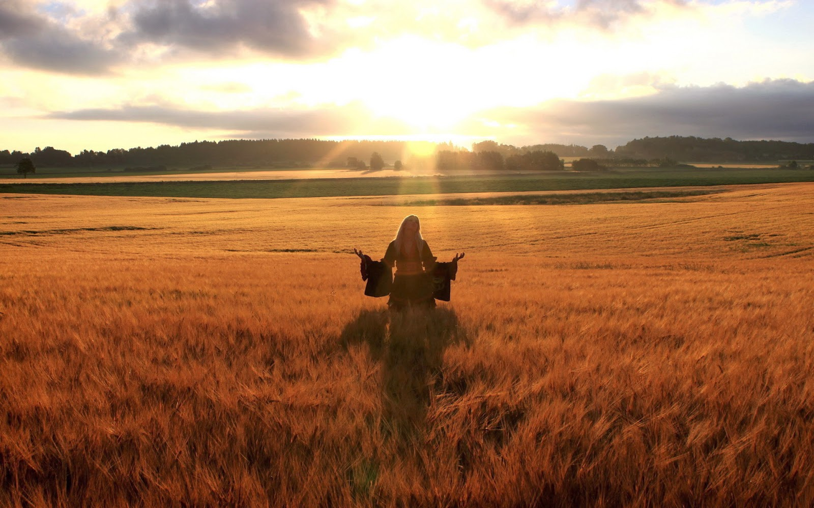 happy-woman-in-golden-wheat-field.jpg