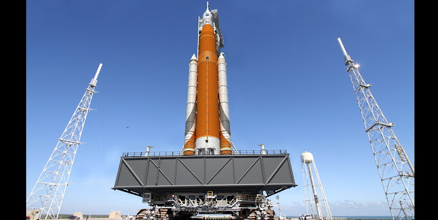 An artist illustration of NASA's Space Launch System rocket and Orion spacecraft on the mobile launcher at Launch Pad 39B at NASA's Kennedy Space Center in Florida. Image credit: NASA