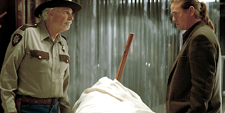 Val Kilmer Hall Baltimore and Bruce Dern as Sheriff LaGrange inspect a corpse, Twixt, directed by Francis Ford Coppola