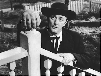 Robert Hitchum as the evil preacher Harry Powell in The Night of the Hunter