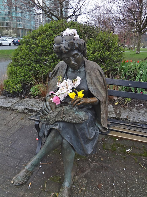statue with flowers in vancouver