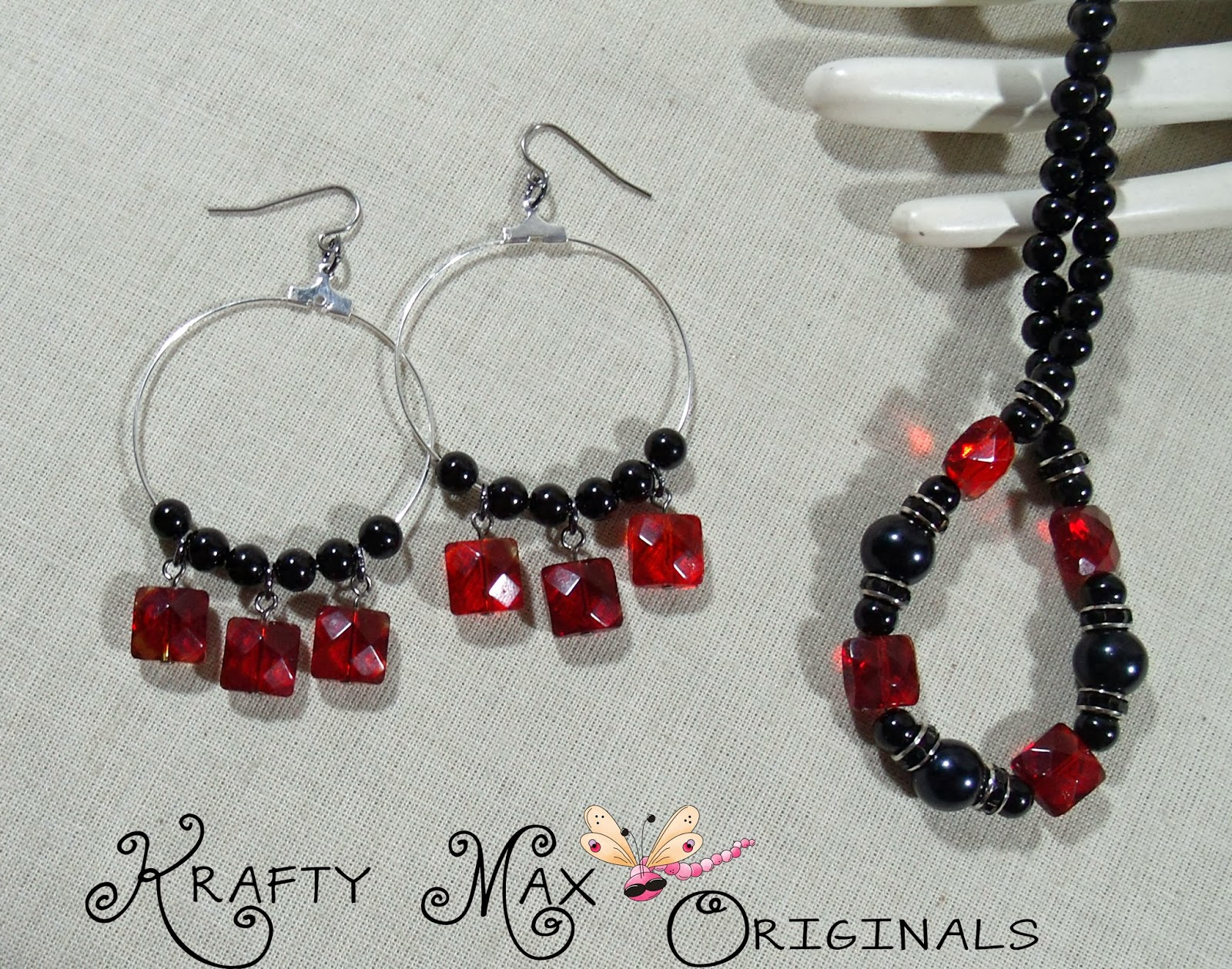 http://www.artfire.com/ext/shop/product_view/KraftyMax/8261951/red_and_black_beauty_prima_beads_blog_team_necklace_set/handmade/jewelry/sets/glass