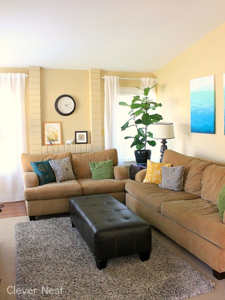Eclectic modern living room. White Ikea Vivan curtains. Blue, yellow, green