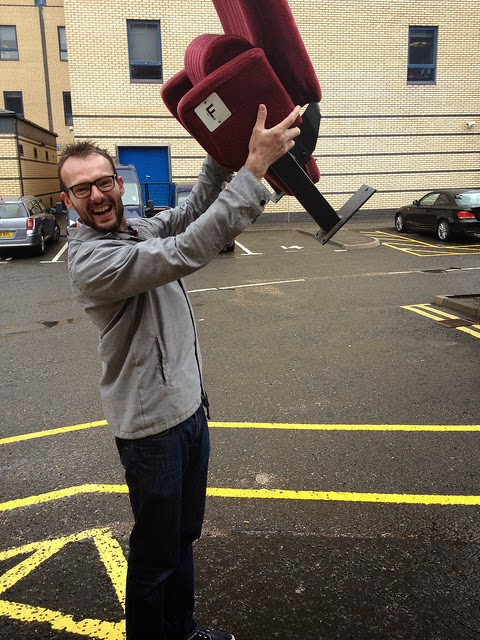 Happy man holding a Citizens Theatre seat