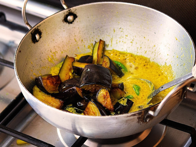 bengali begun posto or egglpant curry with poppy seeds sauce recipe