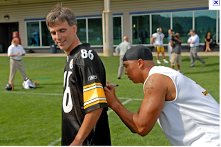 Randy Pausch getting jersey signed by pro football player