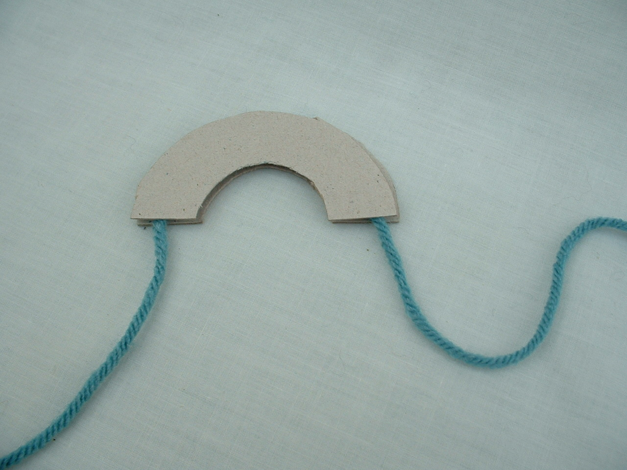how to make a pom pom with cardboard circle