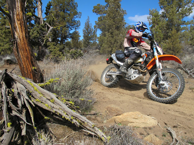 Giant Loop's Dustin Cary roostin' the KTM 500 EXC with MoJavi Saddlebag on trails about 10 minutes ride from the shop.