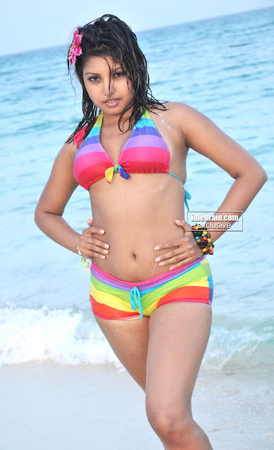 Actress KOMAL Spicy Bikini Stills At The Beach indianudesi.com