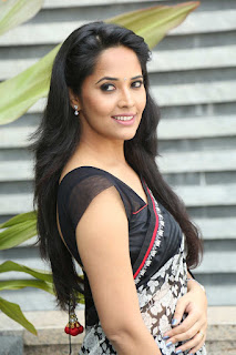 Anasuya Looks so cute and Stunning in Black and white Saree and Sleeveless Backless Choli Blouse