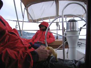 Mike at the helm and Kurt with the banana ride out the storm off the coast of Charleston