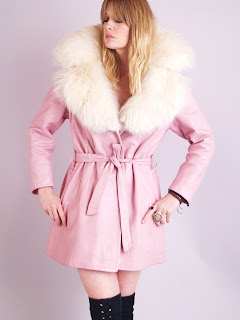 Vintage 1960's pink leather princess coat with white fox fur collar and cuffs.