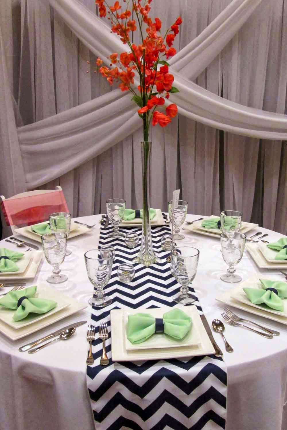 Planning tip 15 diy wedding centerpieces elite events rental twist calla lillies inside a 27 trumpet vase rents for 10 or a 32 pilsner vase rents for 10 combine two vases for a bigger impact reviewsmspy