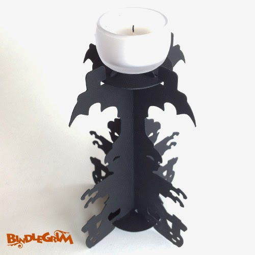 Vintage-style Black Silhouette Candle Holder with Trick or Treat Zombies, Pumpkin Jack O'Lanterns, and Bat Wings for the Halloween holiday by artist Bindlegrim