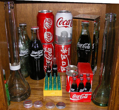 display case of Coke bottles and cans from around the world