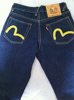 women evisu jeans yellow size28