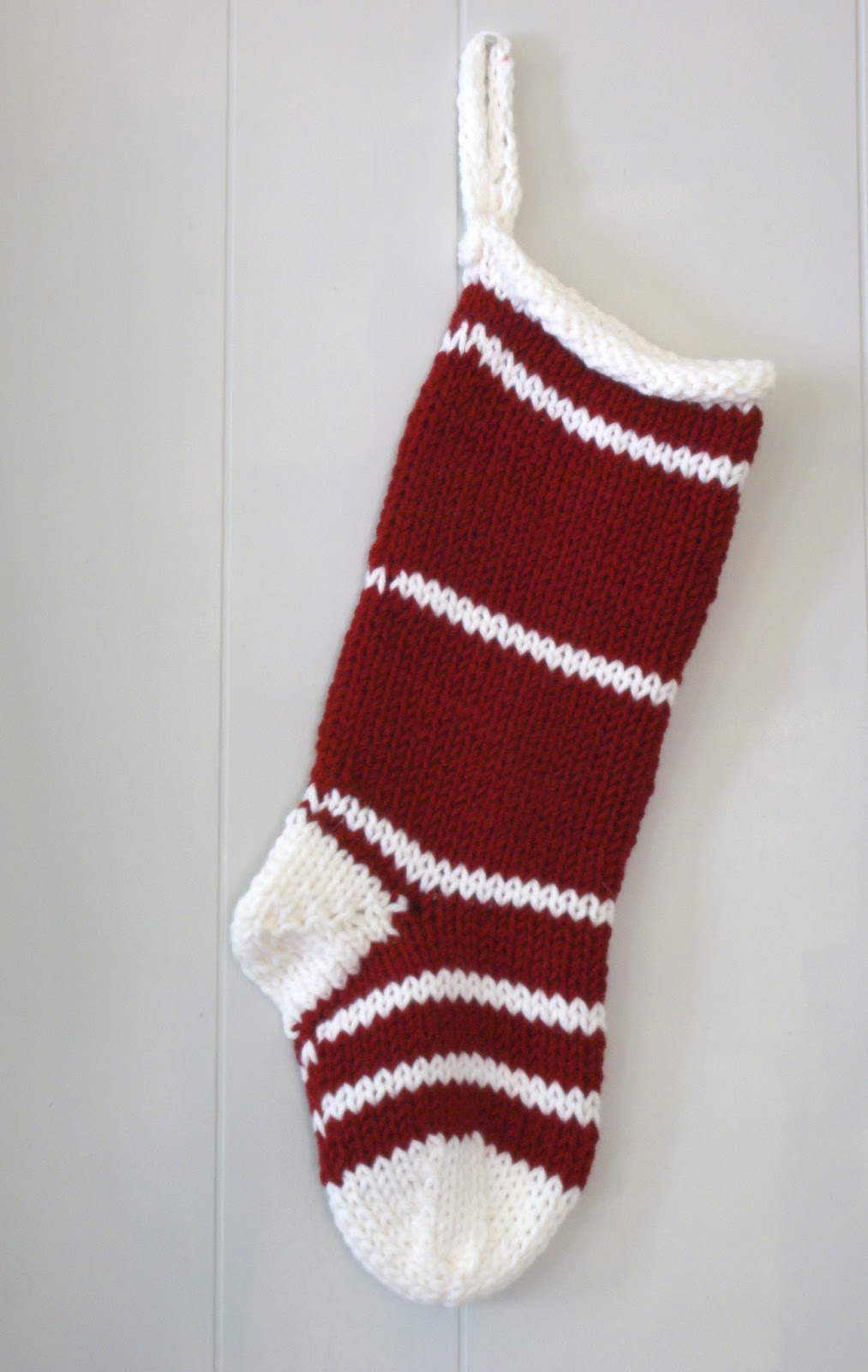 as i said yesterday i was knitting a new christmas stocking for my etsy store and here it is whatcha think i love the classic design and color deep red - White Knit Christmas Stockings