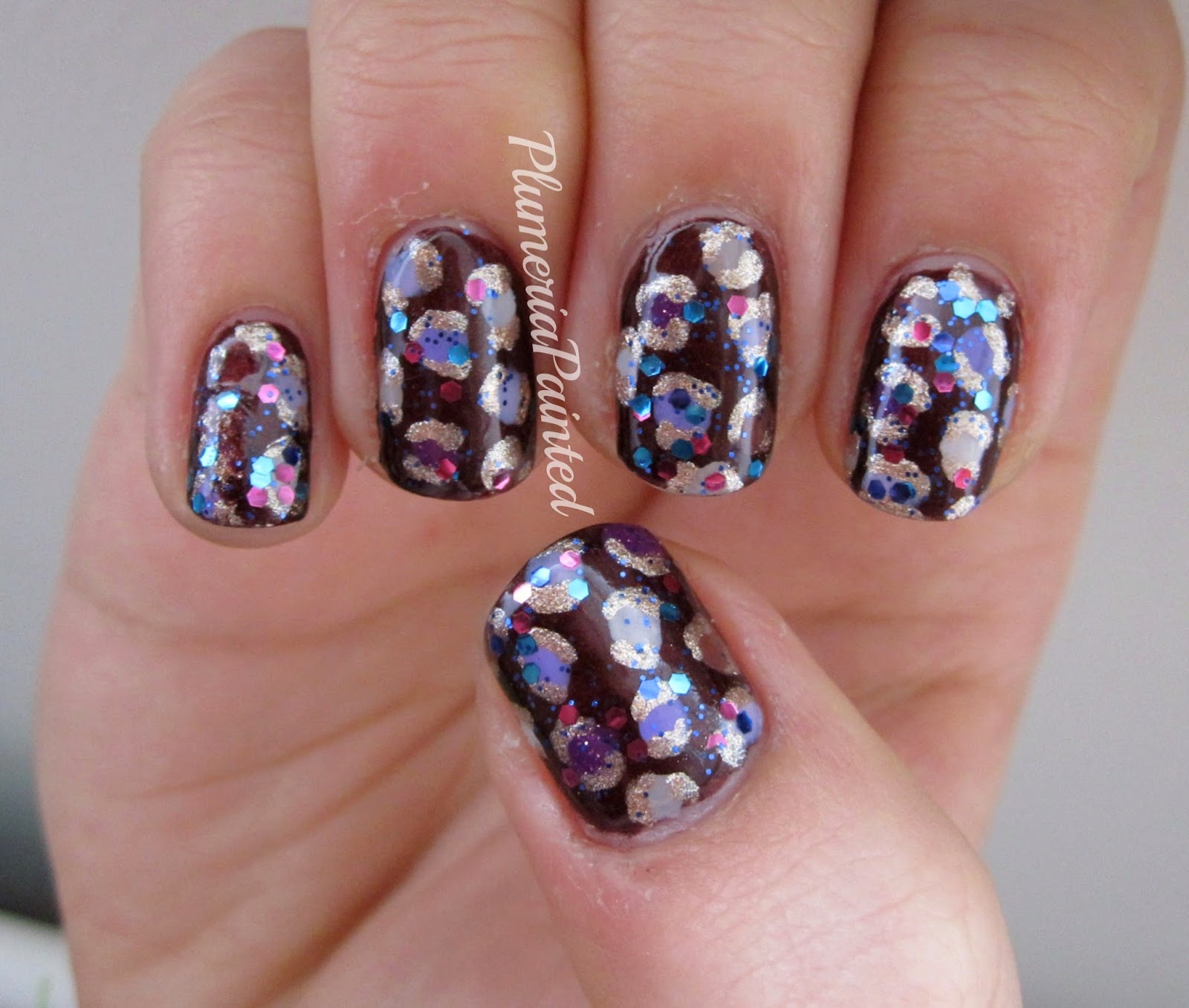 PlumeriaPainted: Purple + brown + glitter leopard print nails