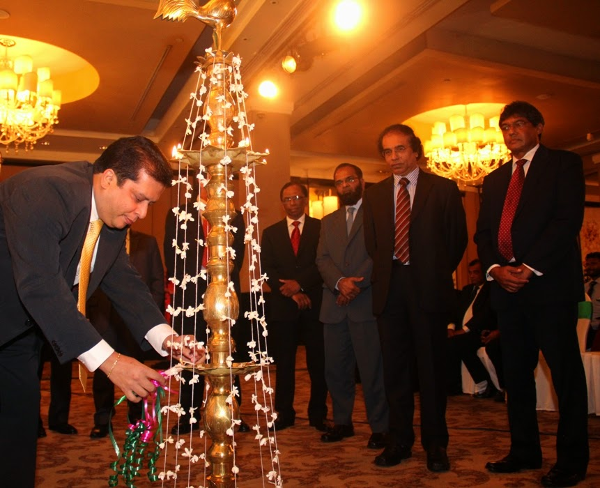 Mr. Lakshman Silva, CEO DVB lighting the official oil lamp