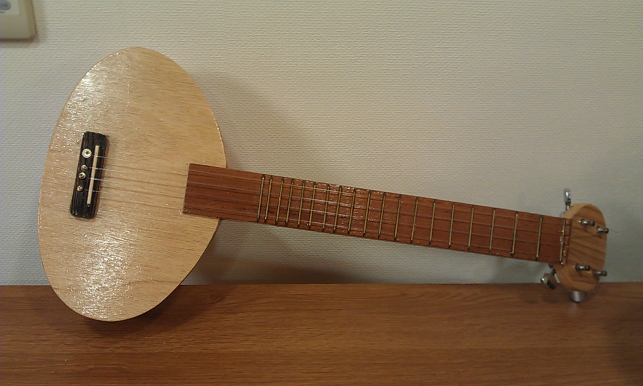 Homemade instruments blog this is homemade ukulele for Homemade diy