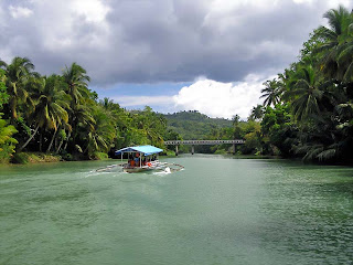 Lovely Travel Around the World RTW -family activities Budget Travel  Loboc river cruise, admire the palms in Philippines