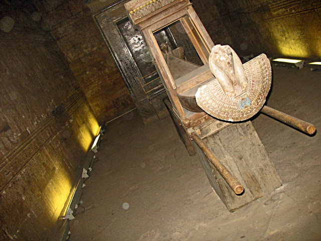 mummy guarded by god horus in edfu temple sanctuary