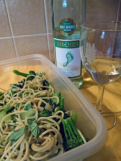 Tupperware with Leftover Spaghetti and Half-empty Wne Bottle