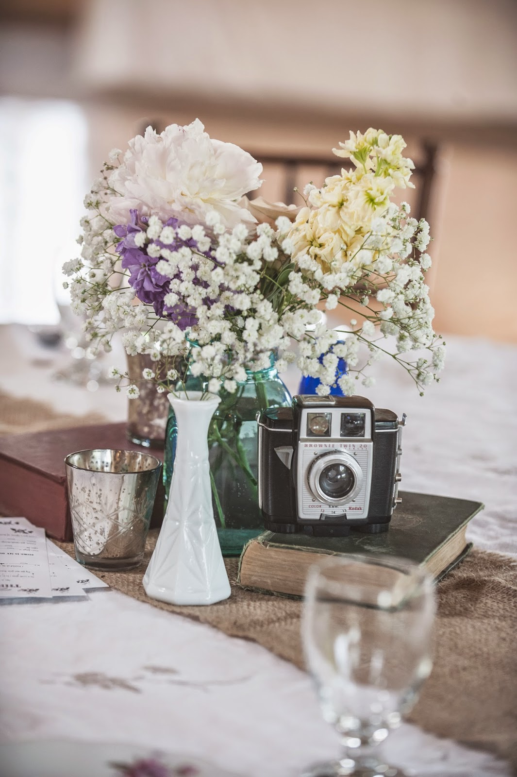 Vintage Milk Glass and Camera Wedding Center Piece: Vintage Rentals KC
