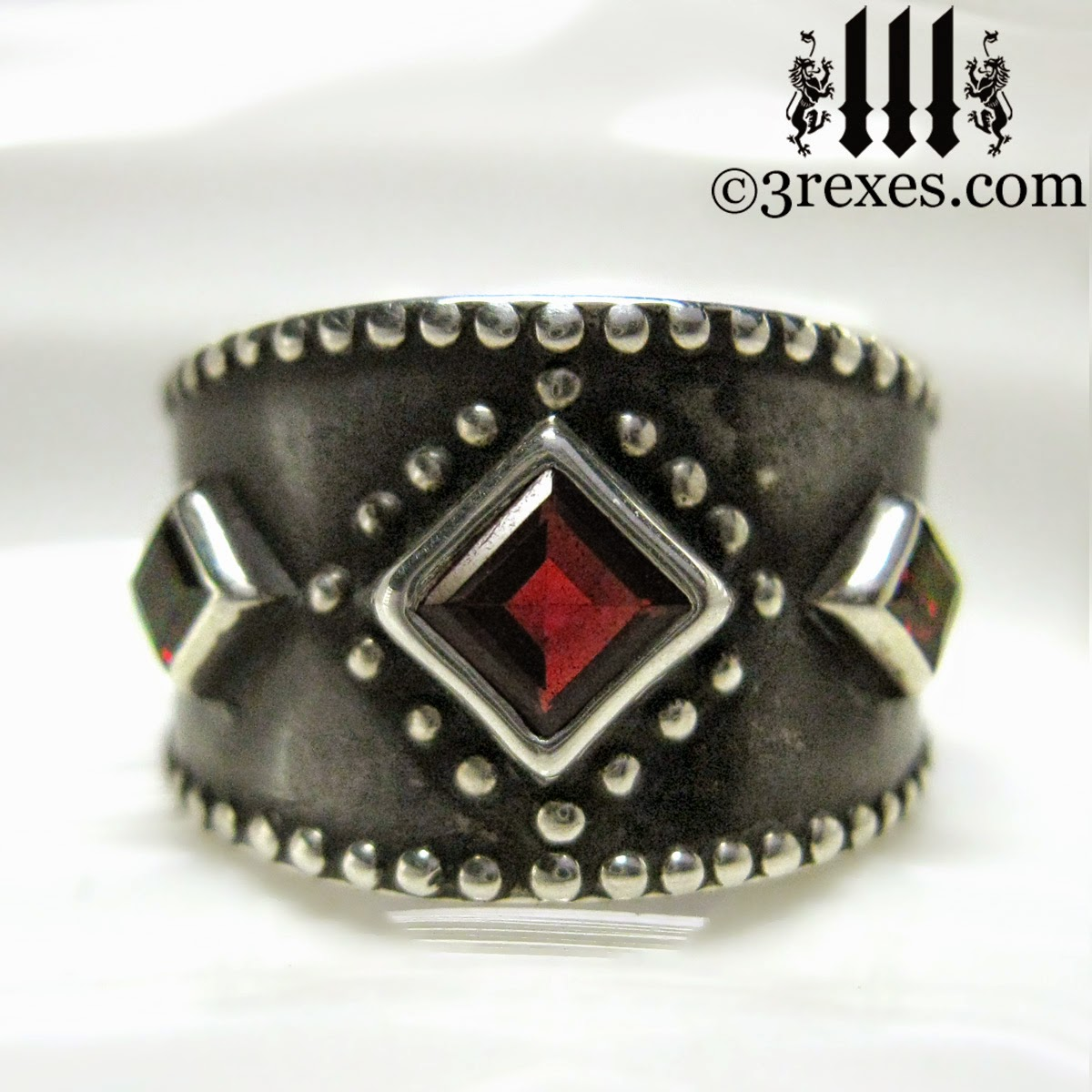 silver 3 wishes medieval wedding ring with garnet