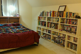 My bedroom over the garage. Bed, bookshelves, slanted ceiling