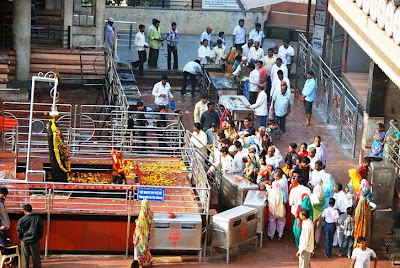 Devotee Taking Darshan at Shani Shingnapur Images