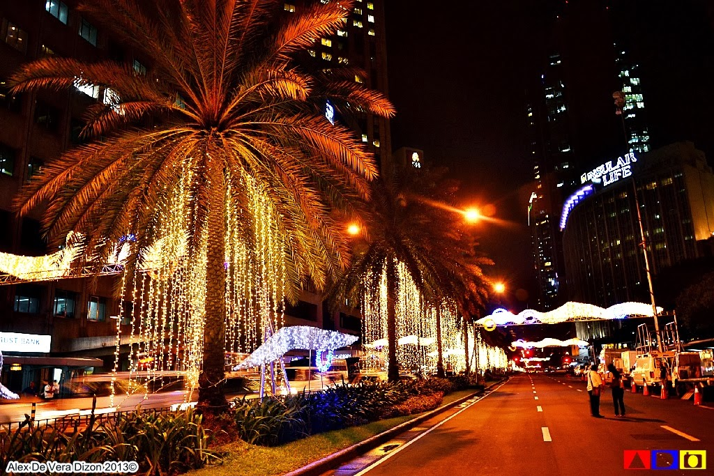 spectacle on the avenues of ayala paseo de roxas and makati makati city has brought the dim lights back through a display of amber colored christmas