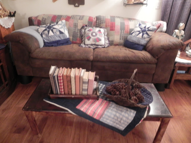 couch, coffee table with book case
