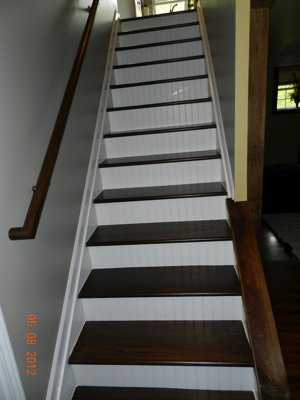 the finished staircase we had the stain custom matched to our kitchen