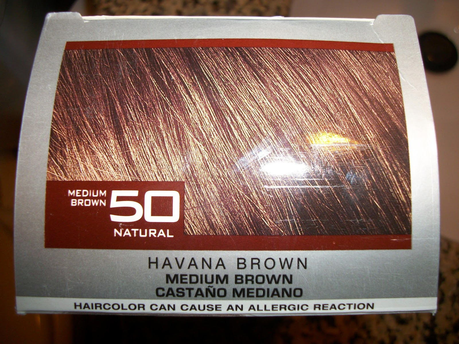 it promised dimension so i bought it in what i estimated to be my regular color which is a darkish brown with reddish tones medium brown havana brown