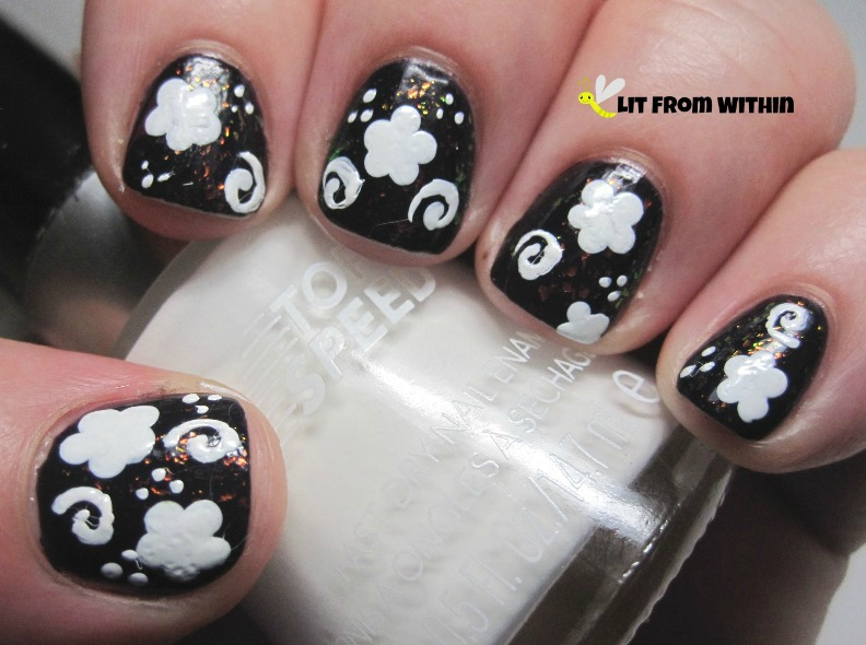 flower and swirl design using Revlon Spirit, a creamy white from their Top Speed line