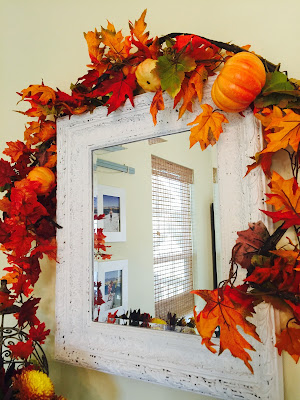 Fall garland over mirror, Fall decorated hutch, Ikea shelving, black and white dishes, Orange Halloween dishes