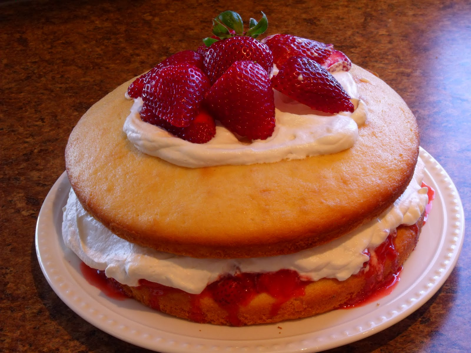 strawberry sponge cake Strawberry cheesecake sponge cake for mothers day luscious strawberry cheesecake layers in light as air sponge cake plus a cheats version of this cake.